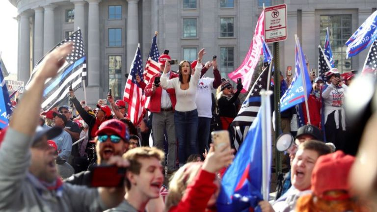 Supporters of U.S. President Donald Trump cheer alongside the presidential motorcade at Freedom Plaza near the White House (Pic: Reuters/Tom Brenner)