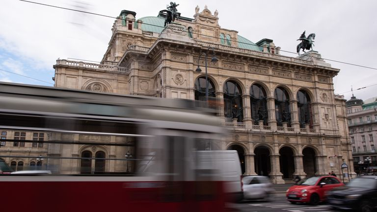 VIENNA, AUSTRIA - MARCH 11: A tram passes by the Vienna State Opera on March 11, 2020 in Vienna, Austria. To help combat the spread of the coronavirus the Austrian government has forbid all indoor events with more than 100 people attending and all outdoor events for more than 500 people. Federal Museums closed after an administrative order by the government. (Photo by Thomas Kronsteiner/Getty Images)