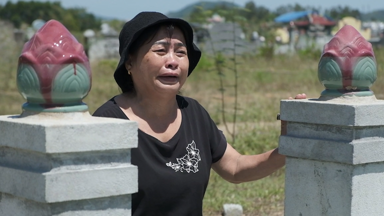 Nguyen Thi Phong visits her daughter's grave