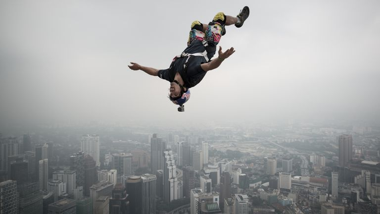 Reffet leaping from the 300m open deck of Malaysia's landmark Kuala Lumpur Tower during the International Tower Jump in 2013