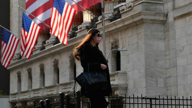 A person walks past the New York Stock Exchange (NYSE) at Wall Street on November 16, 2020 in New York City