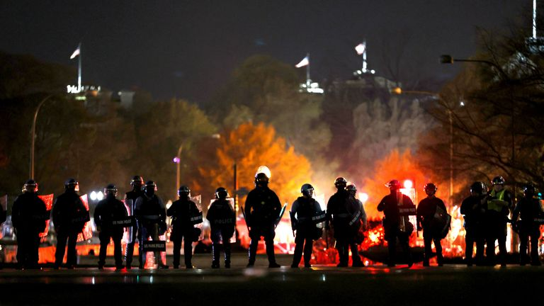"Police officers stand in line as they monitor a protest following the ""Million MAGA March"" from Freedom Plaza to the Supreme Court, on November 14, 2020 in Washington, DC."