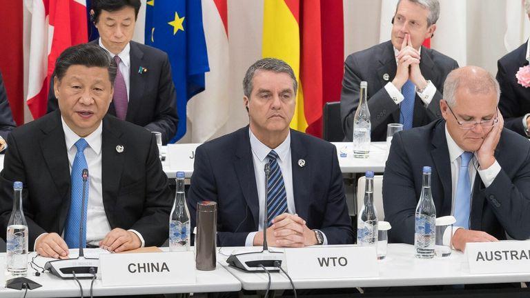 Chinese President Xi Jinping (left) and Australian Prime Minister Scott Morrison (right)