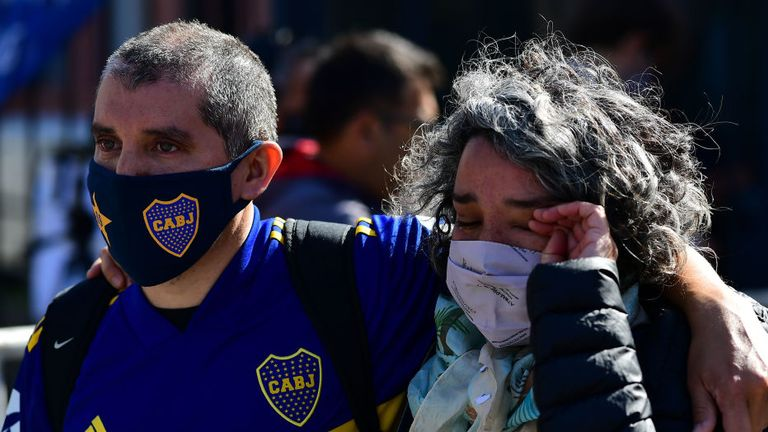 Fans mourn at Diego Maradona's funeral in Buenos Aires