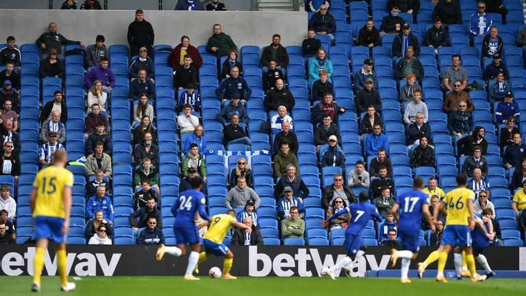 Socially distanced fans watch from the stands during a 'pilot event' football match between Brighton and Chelsea