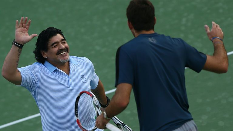 Argentina's football legend Diego Maradona (L) greets his compatriot tennis player Juan Martin Del Potro after a show following Del Potro's victory against India's Somdev Devvarman during the ATP Dubai Open tennis tournament in the Gulf emirate on February 27, 2013.