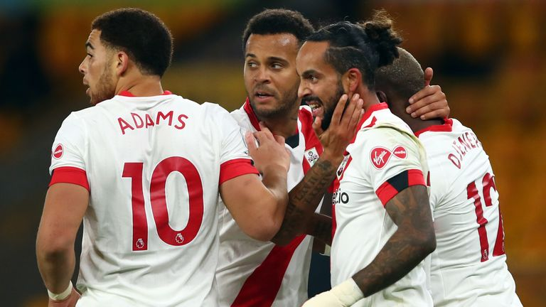 Theo Walcott celebrates scoring for Southampton vs Wolves