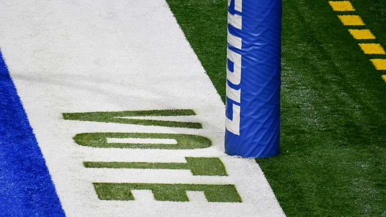 "A detail of ""Vote"" painted in the endzone prior to the game between the Detroit Lions and the Indianapolis."