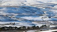 Cottages surrounded by snow in Teesdale, in the Yorkshire Dales
