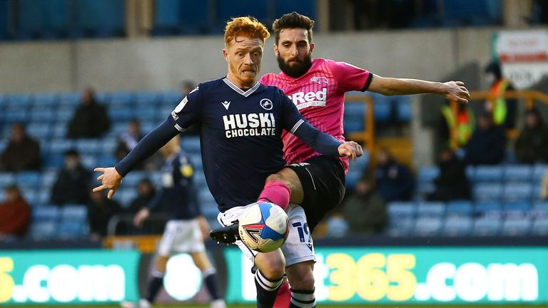 LONDON, ENGLAND - DECEMBER 05: Ryan Woods of Millwall battling for possession with Graeme Shinnie of Derby County during the Sky Bet Championship match between Millwall and Derby County at The Den on December 05, 2020 in London, England. A limited number of fans are welcomed back to stadiums to watch elite football across England. This was following easing of restrictions on spectators in tiers one and two areas only. (Photo by Jacques Feeney/Getty Images)