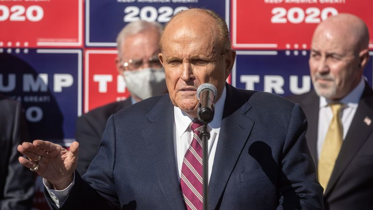 PHILADELPHIA, PENNSYLVANIA - NOVEMBER 07: Attorney for the President, Rudy Giuliani speaks to the media at a press conference held in the back parking lot of Four Seasons Total Landscaping on November 7, 2020 in Philadelphia, Pennsylvania. The press conference took place just minutes after news networks announced that Joe Biden had won the presidency over Donald Trump after it was projected that he had won the state of Pennsylvania. (Photo by Chris McGrath/Getty Images)