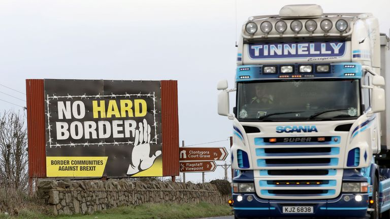 """Traffic passes an """"No Hard Border"""" anti-Brexit, pro-Irish unity billboard poster as it crosses the border road between Newry in Northern Ireland, on February 1, 2020, and Dundalk in Ireland. - Britain began its post-Brexit uncertain future outside the European Union on Saturday after the country greeted the historic end to almost half a century of EU membership with a mixture of joy and sadness. There were celebrations and tears on Friday as the EU's often reluctant member became the first to leave an organisation set up to forge unity among nations after the horrors of World War II. (Photo by Paul Faith / AFP) (Photo by PAUL FAITH/AFP via Getty Images)"""