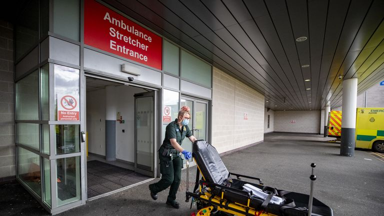An ambulance worker leaves the accident and emergency (A&E) department at Whiston Hospital in Merseyside as the hospital continues to deal with the increasing number of coronavirus patients.