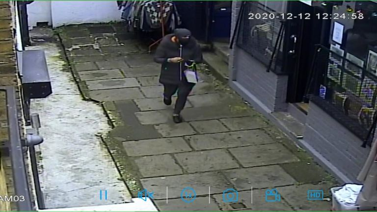 Handout CCTV screengrab dated 12/12/20 issued by the Metropolitan Police of a man wanted in connection with the theft of pocket watch from an antiques shop in north London on Saturday. The 14 carat gold time piece, presented by former US president Woodrow Wilson and worth up to GBP 20,000, was taken from the store in Pierrepont Arcade, Islington, north London at around 12.30pm on Saturday by a man who pretended he wanted to buy a vase.