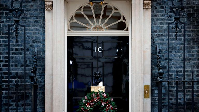 A festive wreath hangs at Door 10 Downing Street in central London on December 13, 2020, as British and European Union leaders agreed to continue talks after the last deadline.  Britain is scheduled to leave the European Union's single market within 19 days.  (Photo by Tolga Akmen / AFP) (Photo by Tolga Akmen / AFP via Getty Images)