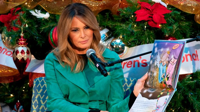 "First lady Melania Trump reads a Christmas book titled, ""Oliver the Ornament Meets Marley and Joan and Abbey,"" at Children's National Hospital on December 15, 2020, in Washington, DC. - Due to pandemic concerns there were two children in the room and the reading was broadcast to children in the rest of the hospital. (Photo by Jacquelyn Martin / POOL / AFP) (Photo by JACQUELYN MARTIN/POOL/AFP via Getty Images)"