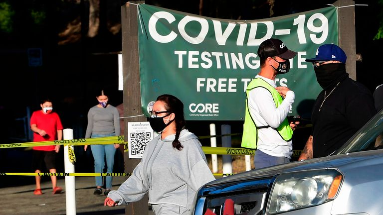A coronavirus test site worker on site to answer questions from people arriving at a testing center in Los Angeles, California on December 16, 2020. - The situation has grown severe across southern parts of California, which was praised for its response at the start of the pandemic in spring, but which has seen Covid-related hospital admissions soar sixfold since mid-October. (Photo by Frederic J. BROWN / AFP) (Photo by FREDERIC J. BROWN/AFP via Getty Images)