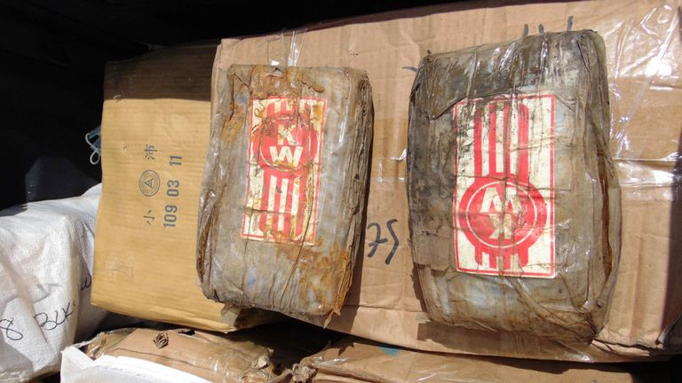 "A photo on December 15, 2020 shows a box filled with one-kilo ""bricks"" of cocaine after a transfer to a police pickup truck from a patrol vessel that transported the cocaine from a remote outer atoll to Majuro for confiscation and destruction. - An 18-foot fiberglass boat was found washed up on Ailuk Atoll, a remote atoll with about 400 people, in the Marshall Islands last week with 649 kilos (1,340 pounds) of cocaine sealed in its hold under the deck. (Photo by Giff JOHNSON / AFP) (Photo by GIFF JOHNSON/AFP via Getty Images)"