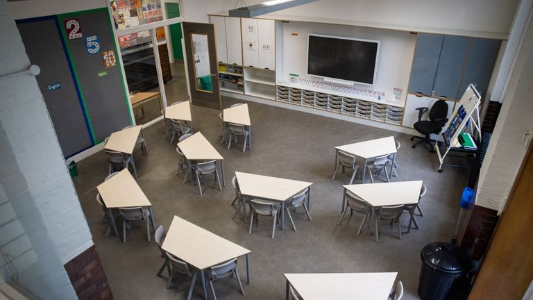 Embargoed to 0001 Friday August 28 Tables and chairs spaced for social distancing in a classroom as The Charles Dickens Primary School in London prepares to safely welcome back pupils.