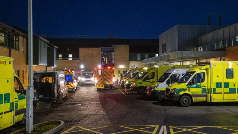 Ambulances at the entrance to the emergency department with a number of the vehicle with patients awaiting to be admitted, at Antrim Area Hospital, Co Antrim in Northern Ireland, as the emergency department and hospital is currently at full capacity.