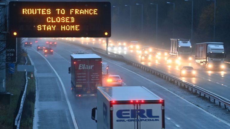 "A sign on the M56 motorway informs drivers that all routes into France are closed at the junction with the M6 at Lower Stretton near Warrington, northwest England, on December 21, 2020. - The British prime minister was to chair a crisis meeting on December 21 as a growing number of countries blocked flights from Britain over a new highly infectious coronavirus strain the UK said was ""out of control"". Crucial transit country France moved to block people and goods crossing the Channel, while the Netherlands said passengers arriving by ferry would be denied entry. (Photo by Paul ELLIS / AFP) (Photo by PAUL ELLIS/AFP via Getty Images)"