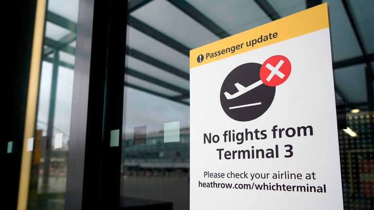 "A sign alerts travels to the closure of Terminal 3 at Heathrow Airport in west London on December 21, 2020, as a string of countries around the world banned travellers arriving from the UK, due to the rapid spread of a new, more-infectious coronavirus strain. - Prime Minister Boris Johnson was to chair a crisis meeting Monday as a growing number of countries blocked flights from Britain over a new highly infectious coronavirus strain the UK said was ""out of control"". (Photo by Niklas HALLE'N / AFP) (Photo by NIKLAS HALLE'N/AFP via Getty Images)"