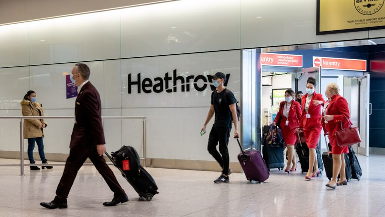 LONDON, ENGLAND - DECEMBER 22:  Passengers arrive at Heathrow Airport just in time for Christmas in a few days on December 22, 2020 in London, England. London and the South East have entered a 'Tier 4' lockdown as a new coronavirus strain is detected in the lead up to Christmas.  (Photo by Joseph Okpako/Getty Images)