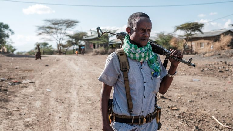 A member of the militia stands holding a gun in the village of Bisober, in Ethiopia's Tigray region on December 9, 2020. - The November 14 killings represent just one incident of civilian suffering in Bisober, a farming village home to roughly 2,000 people in southern Tigray. In retrospect, Bisober residents say, the first sign of the conflict came seven months ago, when members of the Tigray Special Forces took over the village elementary school, which had been emptied because of the coronavirus pandemic. (Photo by EDUARDO SOTERAS / AFP) (Photo by EDUARDO SOTERAS/AFP via Getty Images)