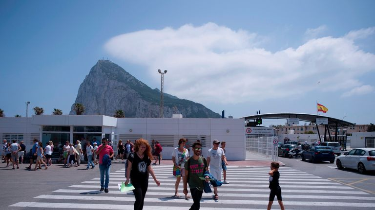A group of people cross the border of the British Colony of Gibraltar in La Linea de la Concepcion on June 2, 2017.  Vaults dug deep inside the Rock of Gibraltar hide a prized treasure: servers that power the websites of online gaming companies, the tiny British territory's main activity whose future is threatened by Brexit. / AFP PHOTO / JORGE GUERRERO        (Photo credit should read JORGE GUERRERO/AFP via Getty Images)