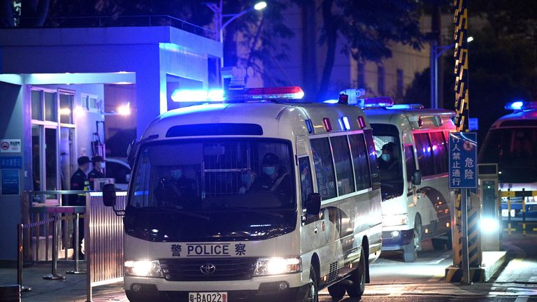 Police vehicles exit Yantian District Peoples Court, where 12 Hong Kong pro-democracy activists who were arrested last August as they tried to flee Hong Kong to Taiwan by boat are on trial, in China's southeastern city of Shenzhen, across the border from Hong Kong, on December 28, 2020. (Photo by Noel Celis / AFP) (Photo by NOEL CELIS/AFP via Getty Images)