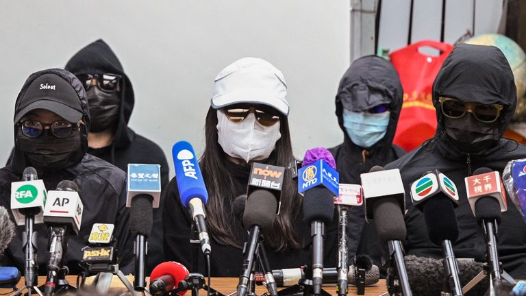 TOPSHOT - Family members of a group of Hong Kong democracy activists, who tried to flee the city by speedboat to Taiwan last August, hold a press conference in Hong Kong on December 28, 2020, the first day of their trial across the border in the Chinese city of Shenzhen. (Photo by Peter PARKS / AFP) (Photo by PETER PARKS/AFP via Getty Images)