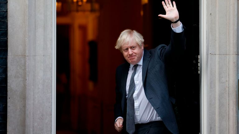 Britain's Prime Minister Boris Johnson gestures to members of the media as he arrives back at 10 Downing Street in London on December 30, 2020, after voting on the second reading of the EU (Future Relationship) Bill in the House of Commons. - Members of the British parliament debated and voted on legislation on the UK's future relationship with the EU as EU leaders signed their post-Brexit trade deal with Britain and dispatched it to London on an RAF jet, setting their seal on a drawn-out divorce. (Photo by Tolga Akmen / AFP) (Photo by TOLGA AKMEN/AFP via Getty Images)