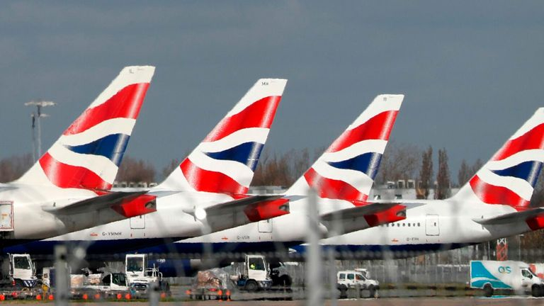 This picture shows British Airways planes grounded at Heathrow's airport terminal 5, in west London, on March 16, 2020.