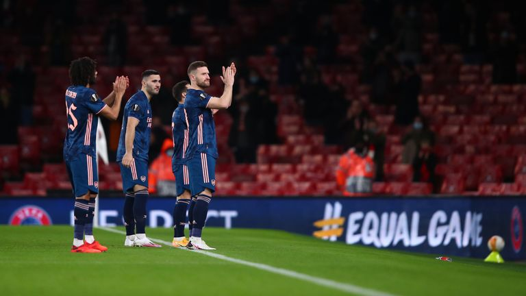 Shkodran Mustafi of Arsenal and some team mates applaud the fans ahead of the UEFA Europa League Group B stage match between Arsenal FC and Rapid Wien at Emirates Stadium on December 03, 2020 in London, England