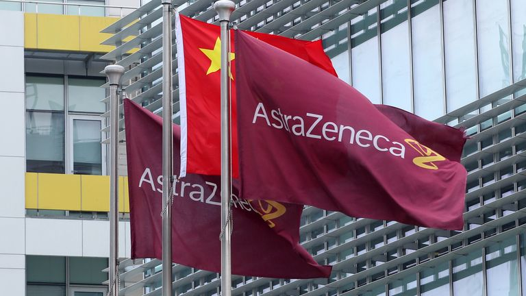 Company flags fly next to the Chinese one outside the headquarters of Britain's AstraZeneca China headquarters in the Zhangjiang district of Shanghai on July 24, 2013.