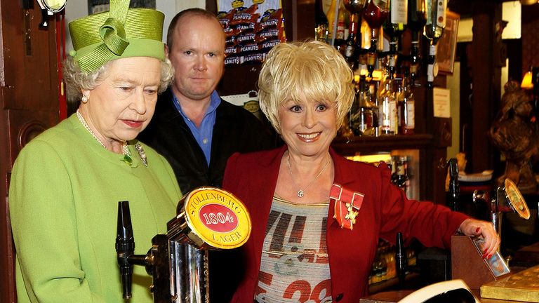 Barbara Windsor with the Queen and actor Steve McFadden in the Queen Vic pub in EastEnders