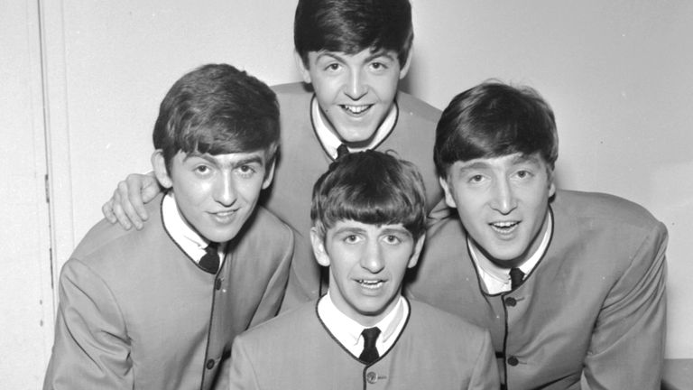 The Beatles pose for an early group portrait wearing Pierre Cardin collarless jackets, (clockwise from left) George Harrison, Paul McCartney, John Lennon, Ringo Starr, 1963. (Photo by Harry Hammond/V&A Images/Getty Images)