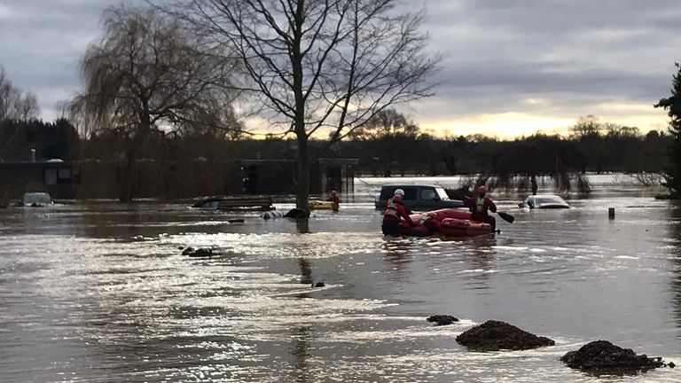 Bedfordshire Fire and Rescue workers help evacuate people in the county after widespread flooding in the area. Pic: Beds Fire and Rescue