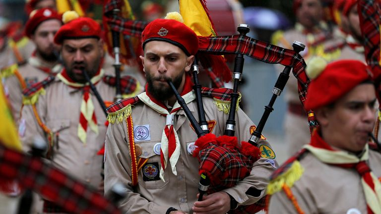 Members of a Palestinian scout band perform outside the Church of the Nativity on Christmas eve, amid the coronavirus disease (COVID-19) outbreak, in Bethlehem in the Israeli-occupied West Bank December 24, 2020. REUTERS/Mussa Qawasma