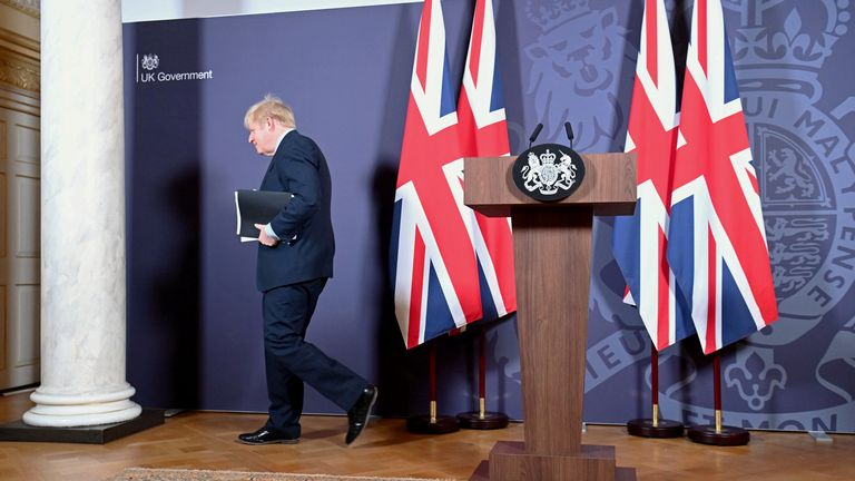 Johnson departs his podium after announcing the trade deal