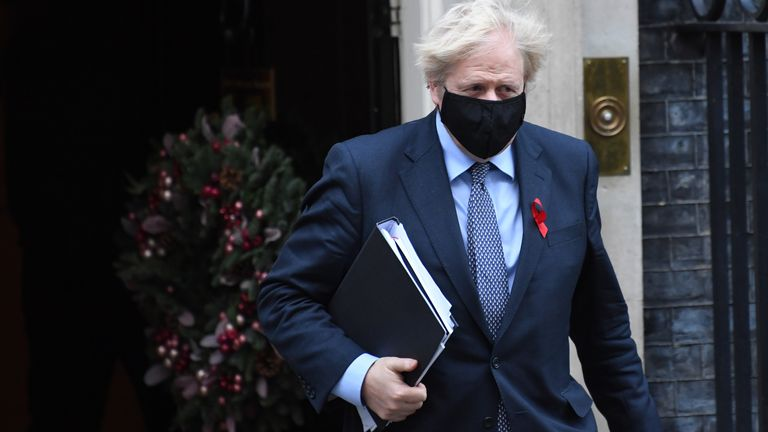 Prime Minister Boris Johnson leaving Downing Street in London to vote on the new coronavirus restrictions for England.
