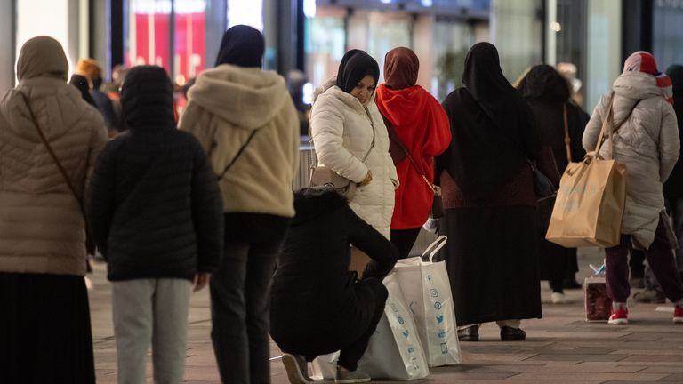 Shoppers queue outside Next in Leicester