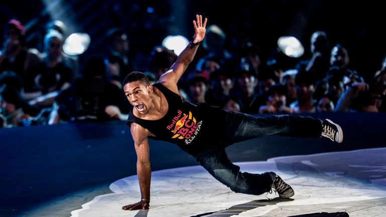 "SEOUL, SOUTH KOREA - NOVEMBER 30: (EDITORIAL USE ONLY) In this handout image provided by Red Bull, Fabiano ""Neguin"" Lopes (R) of Brazil competes against Fouad ""Lil Zoo"" Ambelj (L) of Morocco during the Red Bull BC One breakdancing world finals at Jamsil Arena on November 30, 2013 at Seoul, South Korea. (Photo by Dean Treml/Red Bull via Getty Images)"