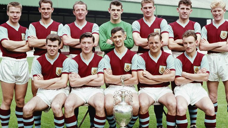 The Burnley Division One championship winning squad of season 1959-60 pose with the trophy at Turf Moor, Burnley, England, selected players include Ray Pointer (back row right)John Connelly (front row left) Jimmy McIlroy (front row second left) Jimmy Adamson (front row centre)