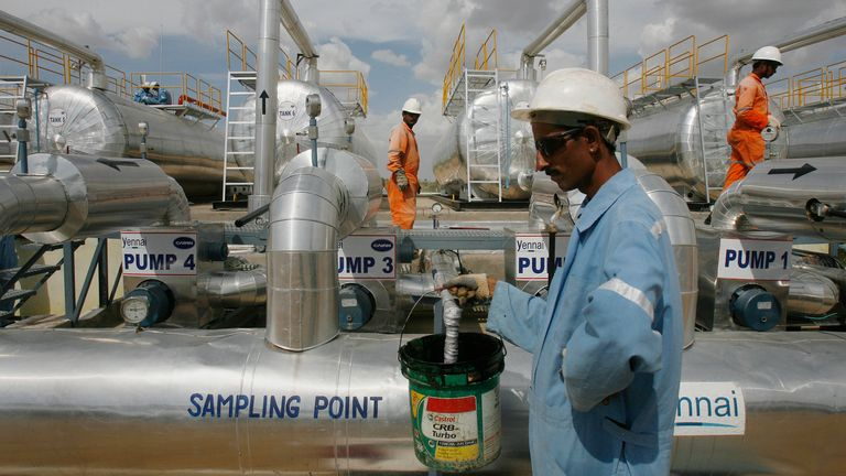 Cairn India employees work at a storage facility for crude oil at Mangala oil field at Barmer in the desert Indian state of Rajasthan