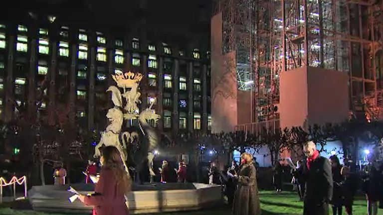 Picture of a socially-distanced Christmas carole ceremony at New Palace Yard, above Parliament's carpark.