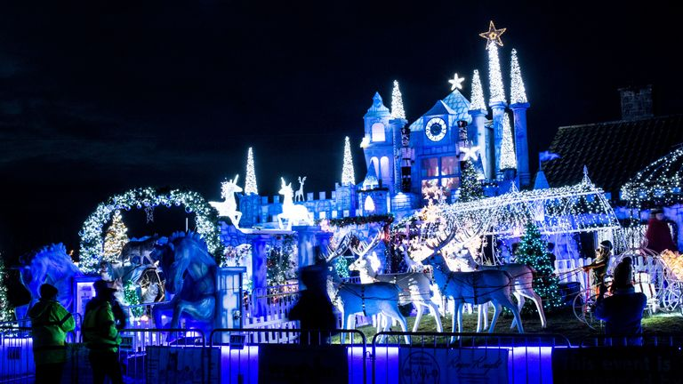 Visitors are asked to contribute to charity if they come to see the extravagant display . Pic: SWNS