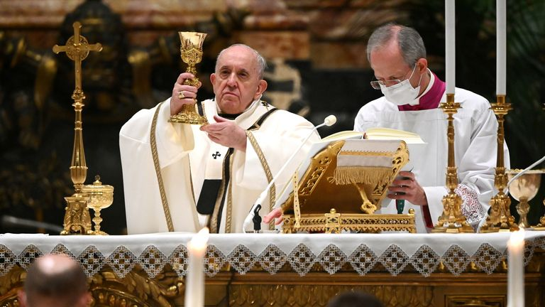 Pope Francis leads the Mass on Christmas Eve in St. Peter's Basilica amid the coronavirus disease (COVID-19) pandemic at the Vatican December 24, 2020. Vincenzo Pinto/?Pool via REUTERS