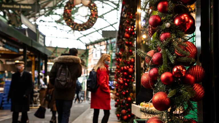 Stallholders in Borough Market, London, prepare for Christmas