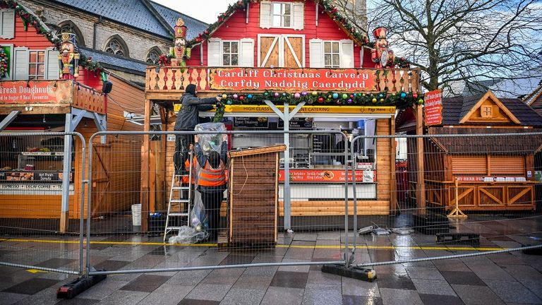 Staff remove Christmas decorations in Cardiff city centre